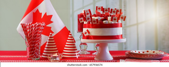 Canada Day national holiday celebration party table with showstopper cake and flags, sized to fit a popular social media cover image placeholder.