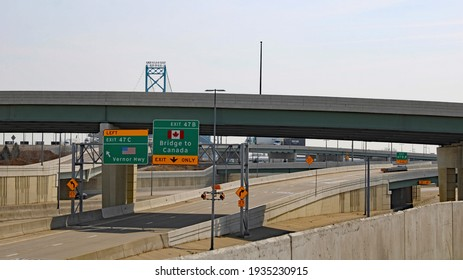 Canada exit sign and Ambassador bridge in the background. Photo taken on March 8, 2021 in Detroit, Michigan, Wayne County, USA.