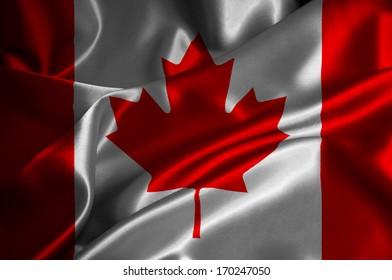 Canada flag on satin texture.