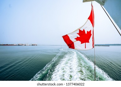 Canada flag over the ocean