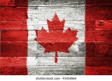 canada flag painted on old wood background