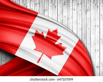 Canada  flag of silk with copyspace for your text or images and wood  background -3D illustration
