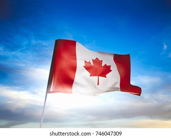 Canada flag waving with pride on a sunny day