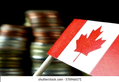 Canada flag waving with stack of money coins macro