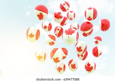 Canada flag in white balloon flying to sky in llight flare