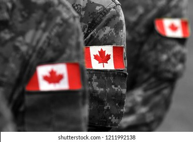 Canada flags on soldiers arm. Canadian troops