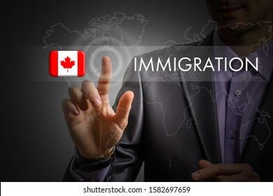 Canada immigration concept. Man pressing virtual button with flag icon