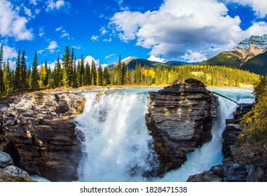 Canada. Indian summer in the Rocky Mountains. The powerful magnificent Athabasca Falls, popular with tourists. Travel and photo tourism concept