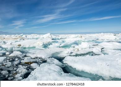 Canada, Nunavut Territory, Midday summer sun lights melting sea ice in Hudson Bay near Arctic Circle