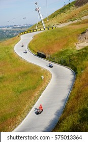 Canada Olympic Park, Calgaary, Alberta, Canada. Aug 25 2013. A group was racing down the hill in luge.