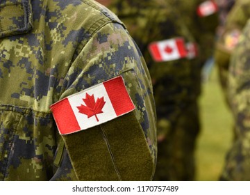 Canada patch flags on soldiers arm. Canadian troops