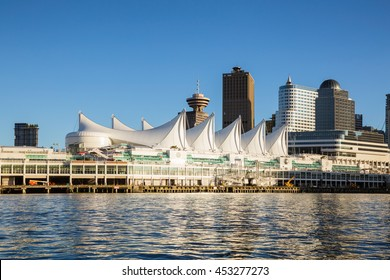 Canada Place and commercial buildings in Downtown Vancouver Viewed from water during sunset.
