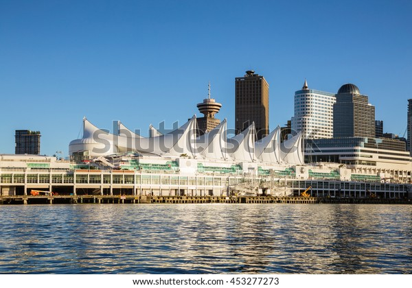 Canada Place and commercial buildings in Downtown Vancouver Viewed from water during sunset.  British Columbia, Canada.