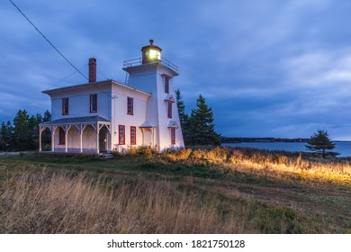 Canada, Prince Edward Island, Rocky Point. Blockhouse Point Lighthouse at the entrance to Charlottetown Harbour.
