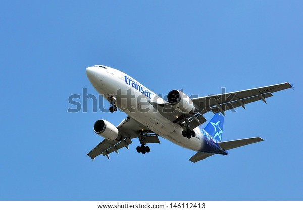 CANADA, QUEBEC, MONTREAL -  JUNE 24: Air Transat flight taking off at Montreal's  Pierre Elliott Trudeau international airport on June, 24, 2013. Air Transat is an important charter carrier in Canada.