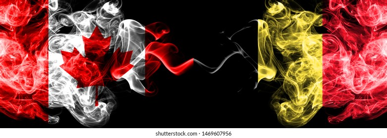 Canada vs Belgium, Belgian smoky mystic flags placed side by side. Thick colored silky smoke flags of Canadian and Belgium, Belgian