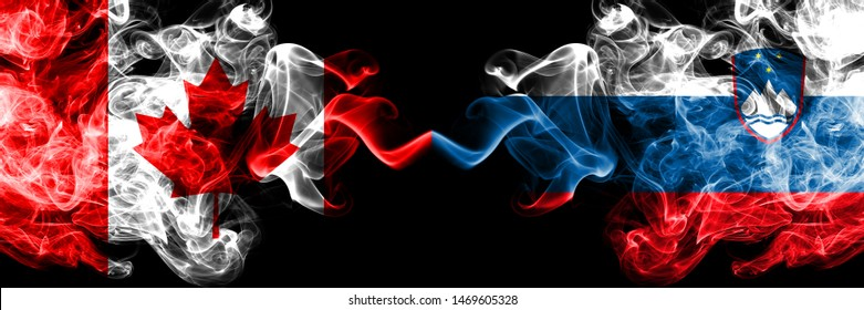 Canada vs Slovenia, Slovenian smoky mystic flags placed side by side. Thick colored silky smoke flags of Canadian and Slovenia, Slovenian