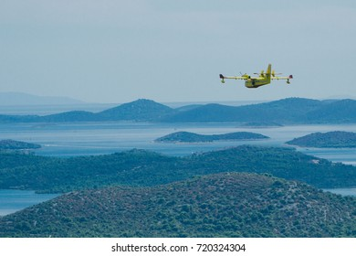 Canadair, Firefighting plane flying over Islands and Lakes, Sibenik, Croatia. September 2017,