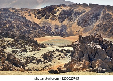 canadas de tenerife in Teide National Park. desert-like landscape in yellow, green, orange with volcanic mountains framed at 2360 m altitude.