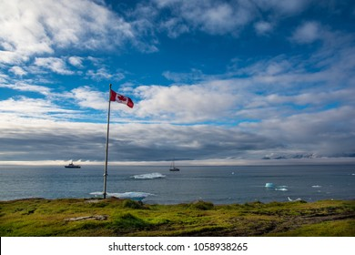 Canada's flag in Pond Inlet. Sea's view.
