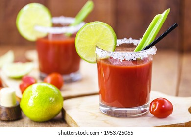 Canadian Caesar drink. Made with vodka, hot sauce and Worcestershire sauce, served with ice in a celery glass with a salted rim, decorated with a celery stalk and lemon slice.