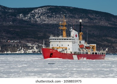 Canadian Coast Guard icebreaker Henry Larsen at work in the Gaspe Bay, Gaspe, Quebec, Canada on March 31, 2018