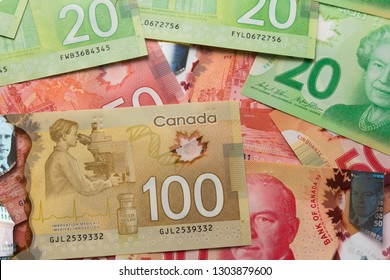 Canadian currency. Dollars. Money from Canada. Overhead view of bills of different amounts.