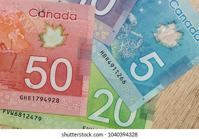 canadian dollar bills on table close up