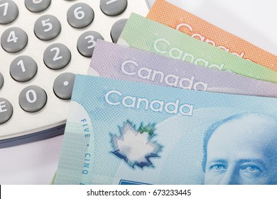 Canadian dollar and calculator, concept of business and finance