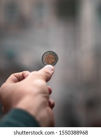 Canadian dollar in the hand of a male