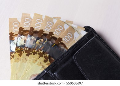 Canadian Dollars in a open black leather vallet