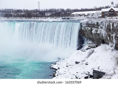 The Canadian Falls known as the Horseshoe Falls or Rainbow Falls in beautiful winter white after a layer of fresh snow has coated the surrounding world.
