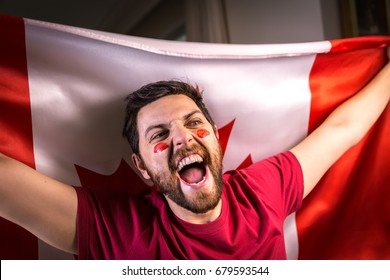 Canadian fan holding the national flag