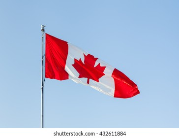 Canadian Flag.  The Canadian flag was adopted in 1965 and features a red maple leaf on a vertical red and white triband.