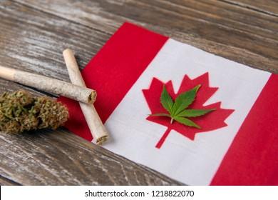 Canadian flag with assorted marijuana products - medical marijuana concept background