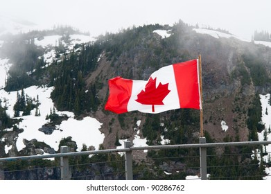 Canadian flag blowing in the wind in the alpine.