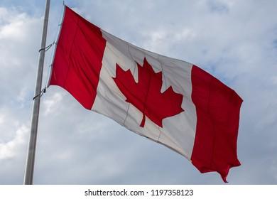 Canadian flag with blue sky