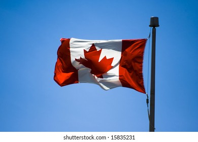 Canadian flag in a blue sky