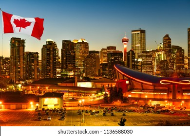 Canadian flag in Calgary city skyline at twilight time, Alberta,Canada