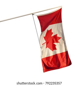 Canadian flag flying from an angled wall-mounrted pole, isolated on a white backfround.