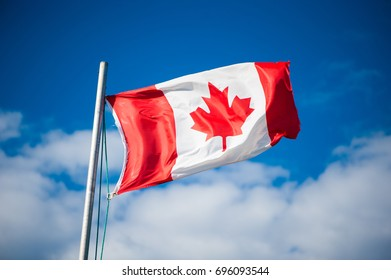 Canadian flag flying in the breeze