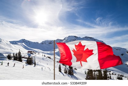 Canadian flag flying at the top of the Rendezvous on top of Whistler Mountain.