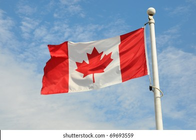 Canadian flag flying in the wind