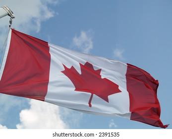 canadian flag on a blue sky
