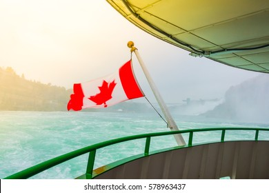 Canadian flag on a boat at Niagara Falls  ( Filtered image processed vintage effect. )