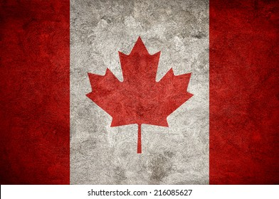 Canadian flag on the grunge concrete wall