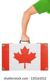 The Canadian flag on a suitcase. Isolated on white.