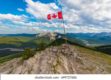 Canadian Flag on top of Sunrise Hill and in Kananaskis Country Alberta Canada