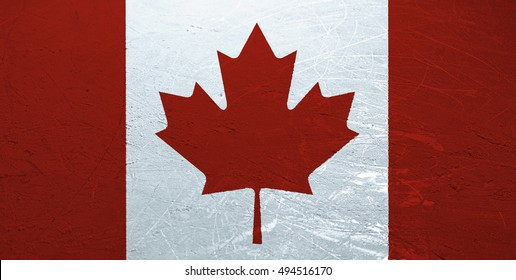 A Canadian flag stamped onto the surface of an ice rink.