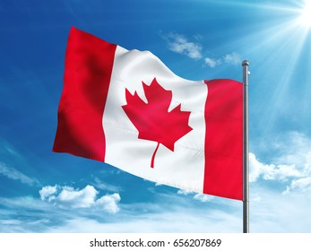 Canadian flag waving in the blue sky
